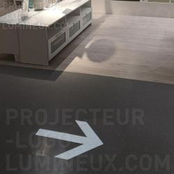 Projection light arrow on the floor as an Ikea store