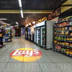 Projection logo lumineux retail merchandising