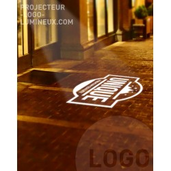 Sidewalk illuminated logo projection